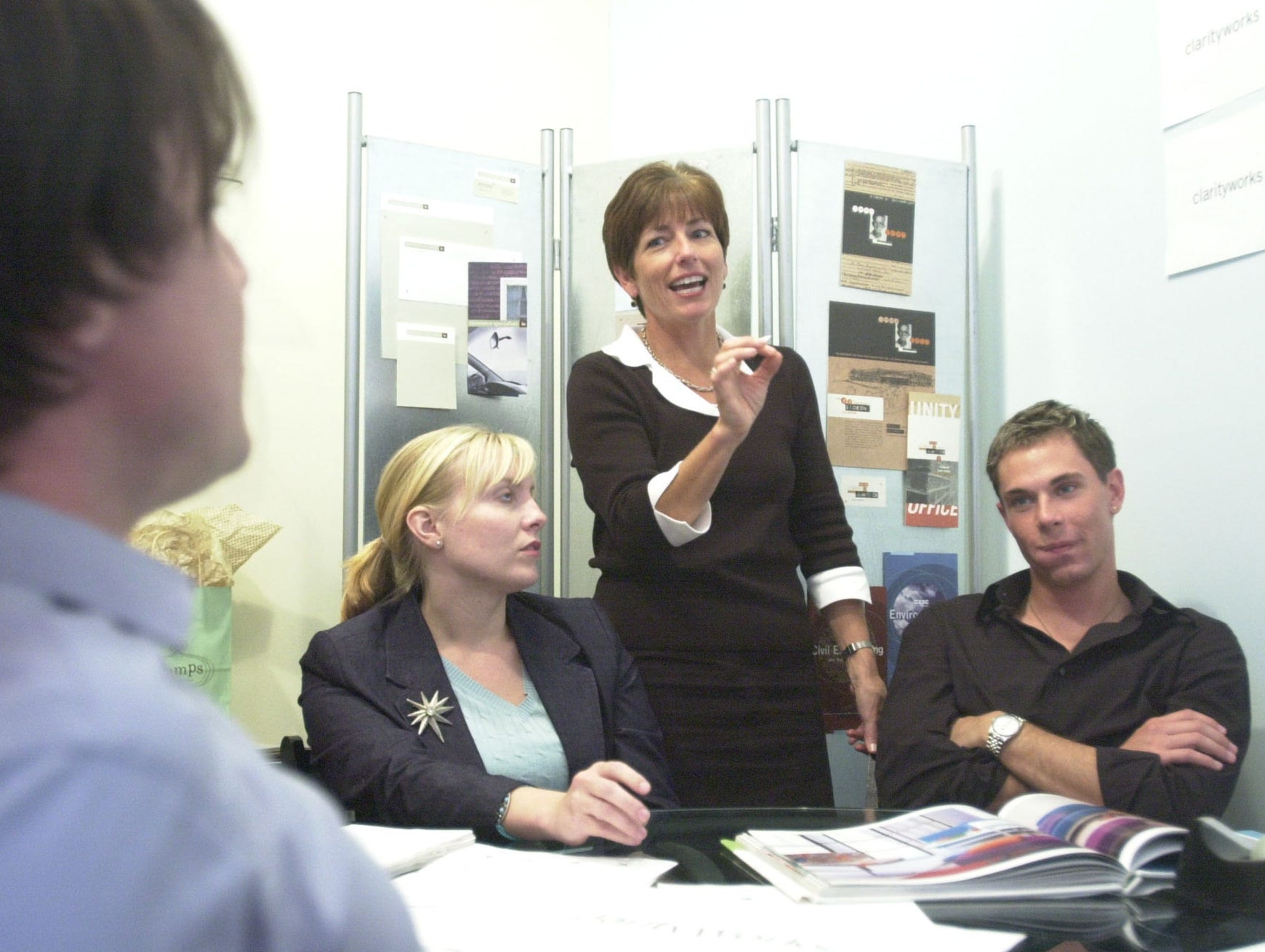 The staff at ClarityWorks have discussions on the design of a new logo Thursday at their offices in the Old City. From left are Arron Russell, Jude Waters, Carol Evans, and Josiah Morgan in 2003.