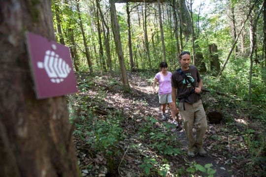 """Appalachian Mountain Bike Club president Brian Hann, right, and Legacy Parks Foundation Carol Evans hike along the Lost Chromosome Trail which is part of the Knoxville's Urban Wilderness trail system in South Knoxville Thursday, Sept. 20, 2012. The hike follows the Lost Chromosome and Chain Ring Trails forming what is known as a """"lollipop loop"""" for approximately four miles."""