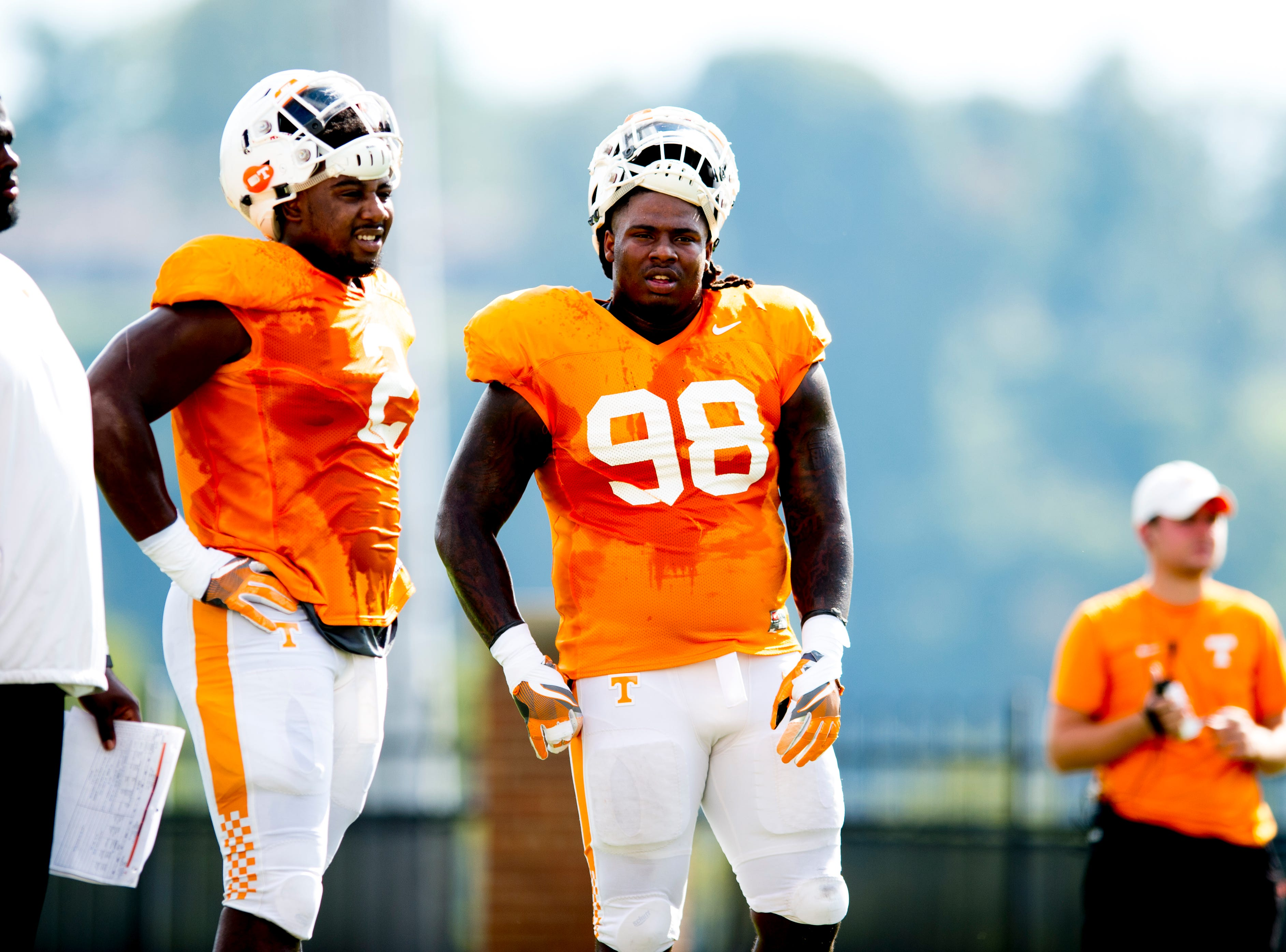 Tennessee defensive lineman Shy Tuttle (2) and Tennessee defensive lineman Alexis Johnson Jr. (98) take a break during Tennessee fall football practice at Haslam Field in Knoxville, Tennessee on Wednesday, September 12, 2018.