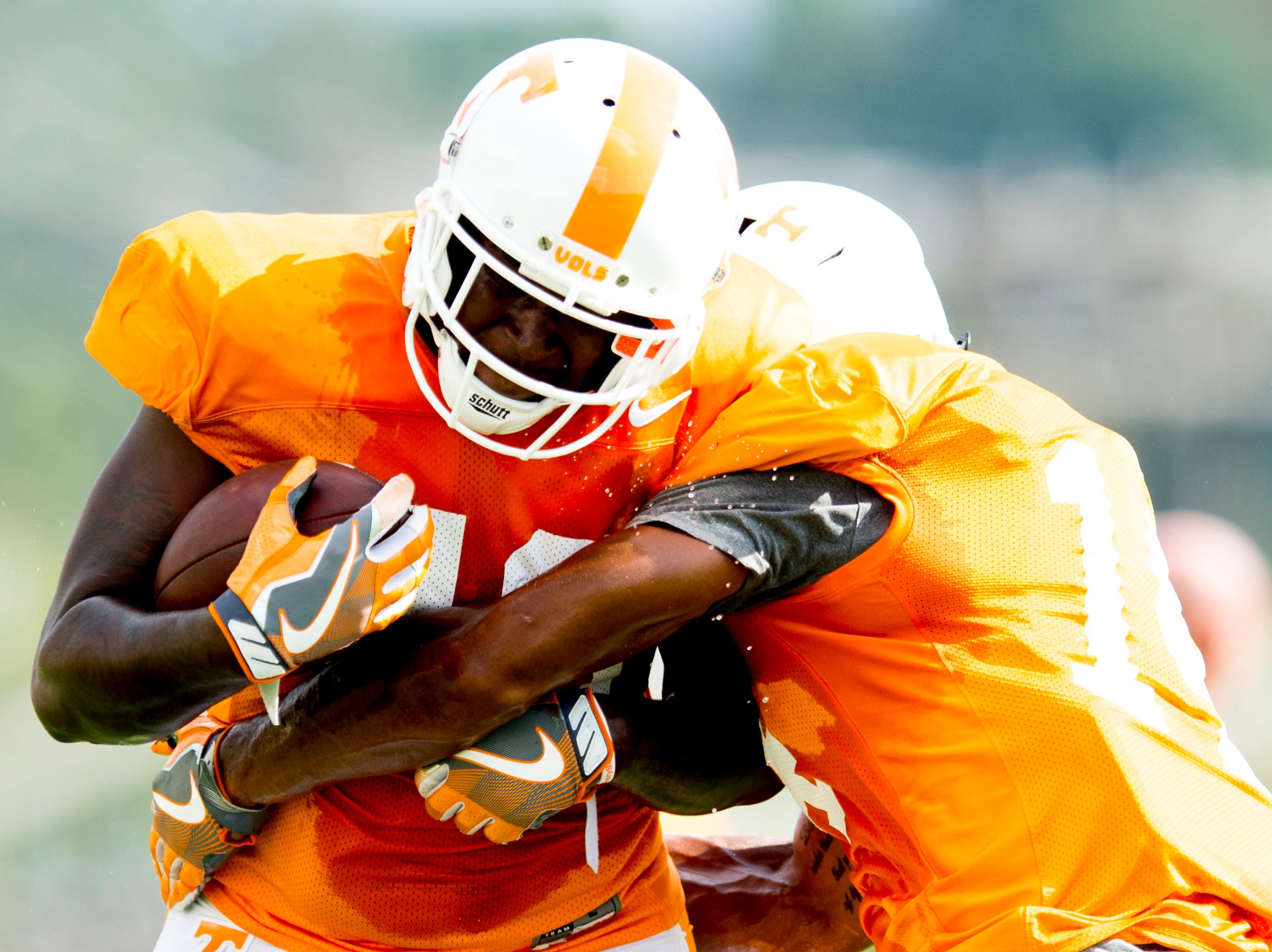 Tennessee linebacker JJ Peterson (40) and Tennessee linebacker Quart'e Sapp (14) drill during Tennessee fall football practice at Haslam Field in Knoxville, Tennessee on Wednesday, September 12, 2018.