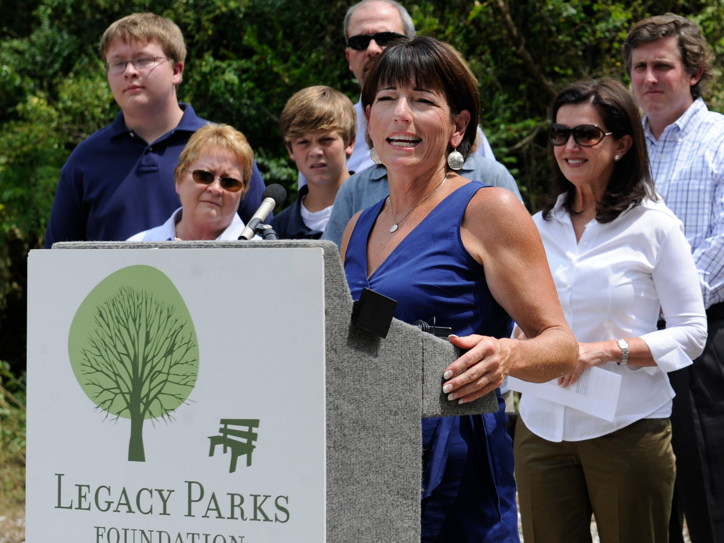 Carol Evans, executive director of the Legacy Parks Foundation, addresses the crowd as the LPF announces an expansion to Knoxville's Urban Wilderness, Tuesday, Aug. 27, 2013. The Wood Family donated 100 acres of future trail and park land, located off Taylor Rd.
