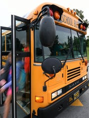 Students get off the bus Wednesday, Sept. 12, 2018, at Karns Middle School.