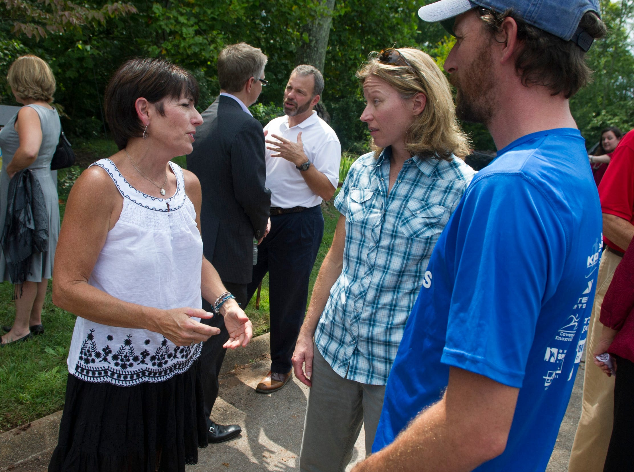 Legacy Parks Foundation executive director Carol Evans, left, talks with Appalachian Mountain Bike Club members Diane Reynolds, center, and Jason Stephens, right, near the Marj McClean entrance to the South Loop Trail on View Park Drive in South Knoxville Tuesday, Aug. 14, 2012.
