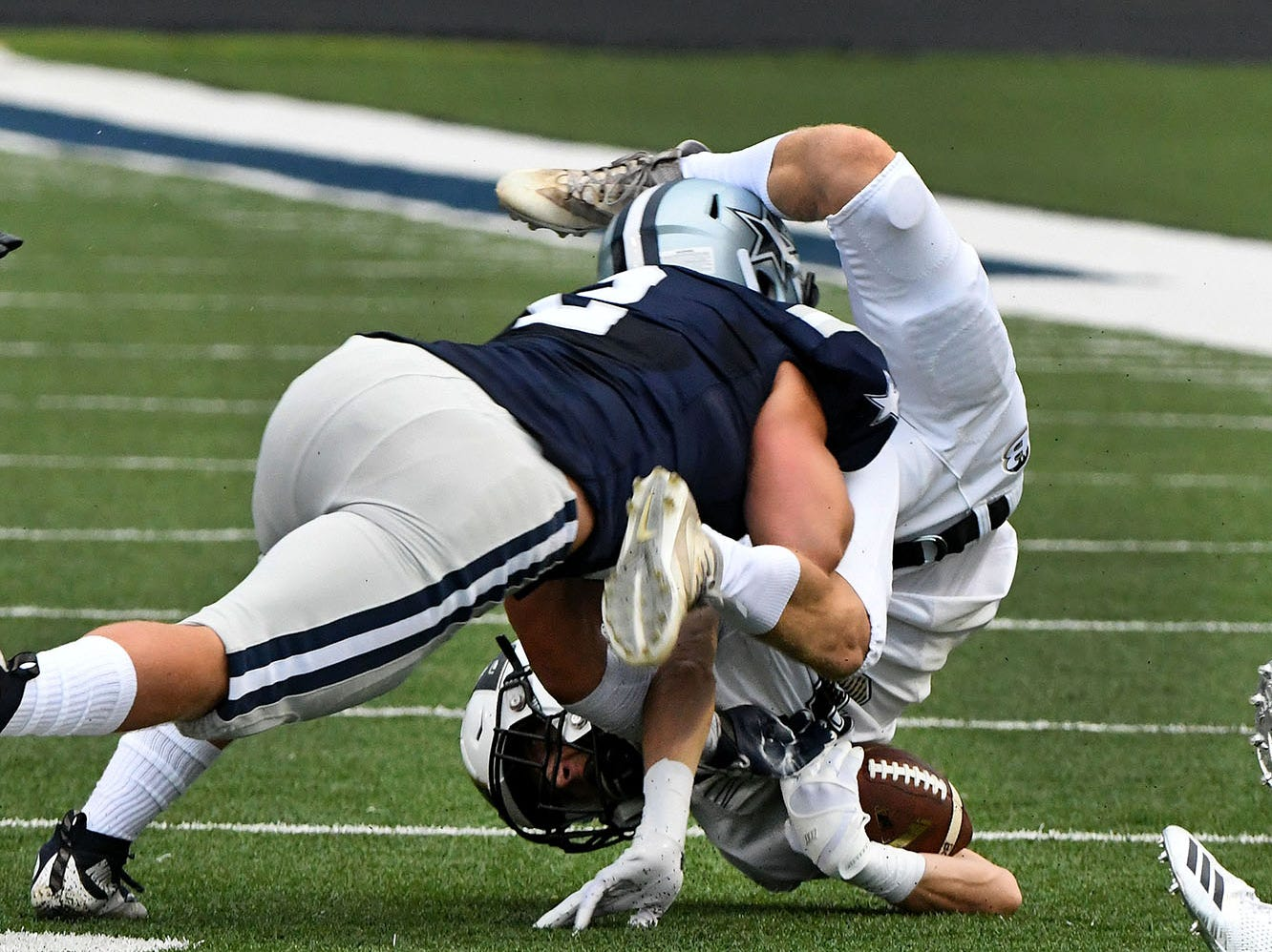 Bradley Central runner is taken down by Farragut's Caleb Kuhn (2) during their game Friday, August 17, 2018 at Farragut High School.