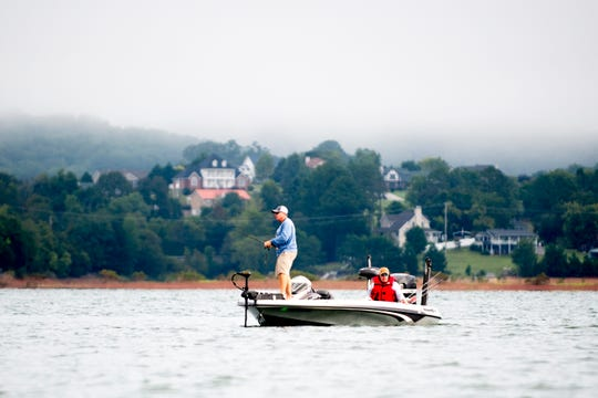 A fisherman fishes in the distance during a practice round ahead of the Bassmaster Eastern Open on Douglas Lake in Dandridge, Tennessee on Wednesday, September 12, 2018.