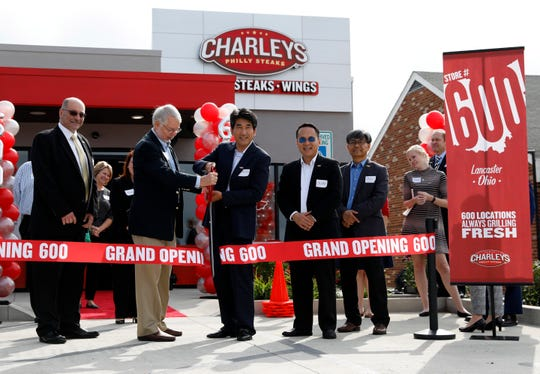 Charley Shin, right, Lancaster Mayor David Scheffler, left, cut the ribbon at the opening of the new Charleys Philly Steaks Wednesday, Sept. 12, 2018, in Lancaster.