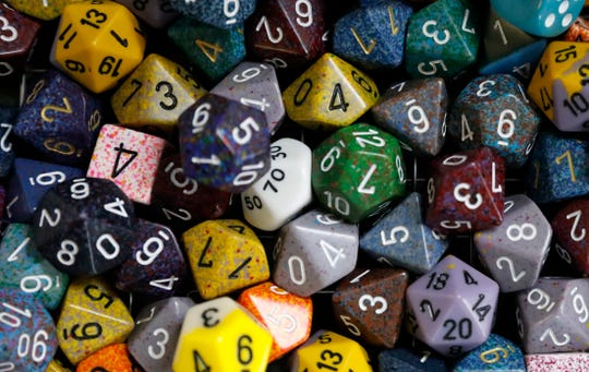 A basket of dice sits on the checkout counter at Odyssey Games in Lancaster.