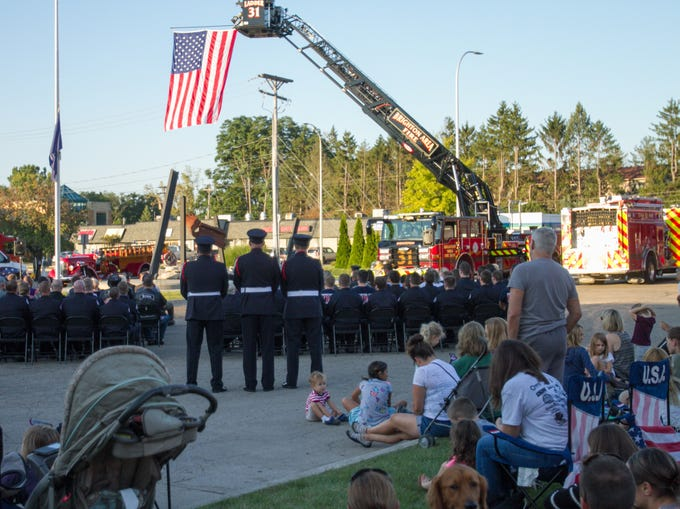 A large crowd filled chairs or stood in the during the 9/11 memorial ceremony held at the Brighton Area Fire Authority's Station 31 Tuesday, Sept. 11, 2018.