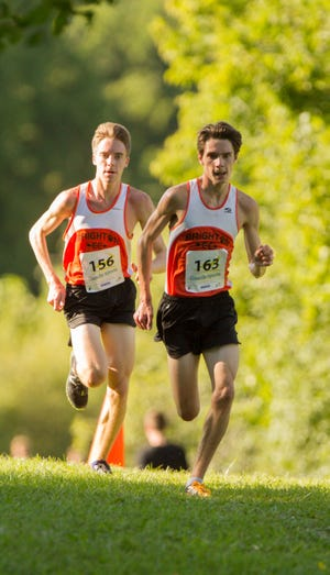 Brighton's Jack Spamer (left) and Zach Stewart broke 15:50, leading the Bulldogs to the team title at the Spartan Invitational's Spartan Elite race.