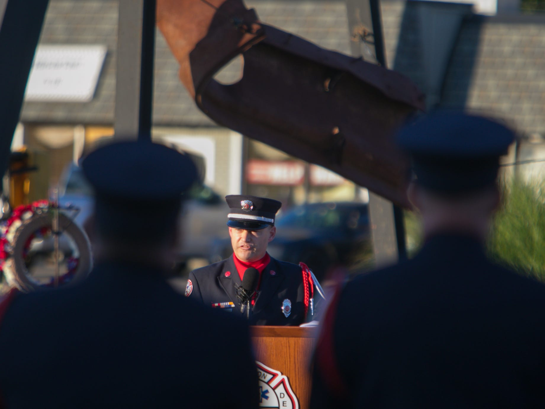 Brighton Area Fire Authority Capt. Greg Mowbray speaks at the 9/11 memorial ceremony Tuesday, Sept. 11, 2018.