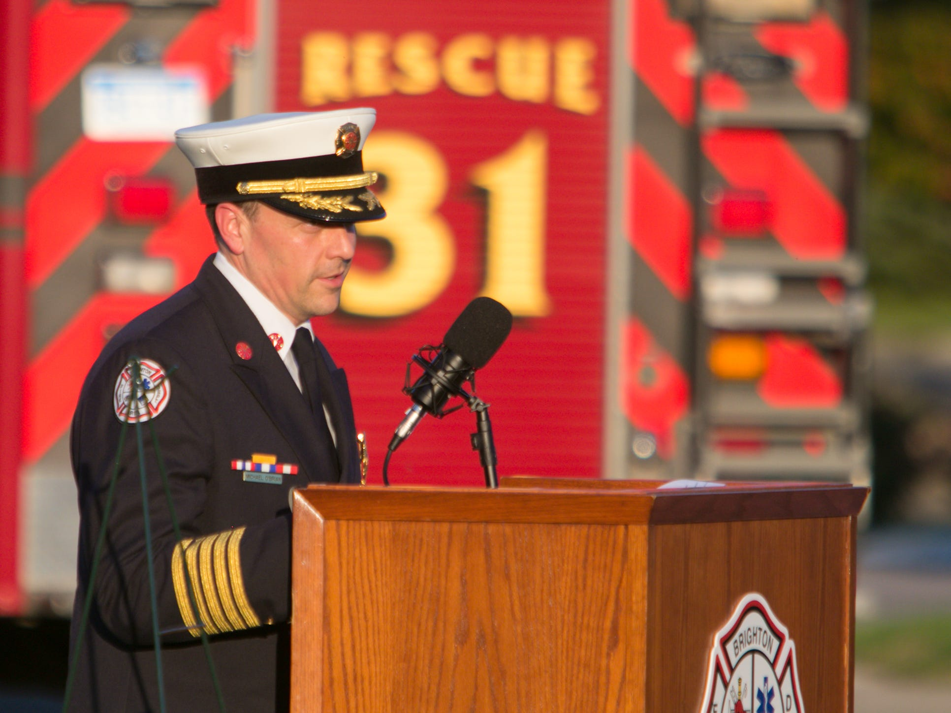 Brighton Area Fire Authority Chief Michael O'Brian wraps up the 9/11 ceremony held at Station 31 Tuesday, Sept. 11, 2018.