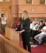 Linda Walker, attorney and Unadilla Township supervisor, speaks about her treatment before District Court Judge Theresa Brennan in a town hall-style hearing Wednesday, Sept. 12, 2018.