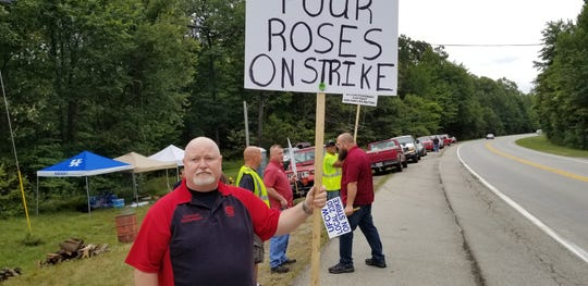 Four Roses workers on strike. They have rejected the company's proposed two-tier system, which they say could weaken the union's power.
