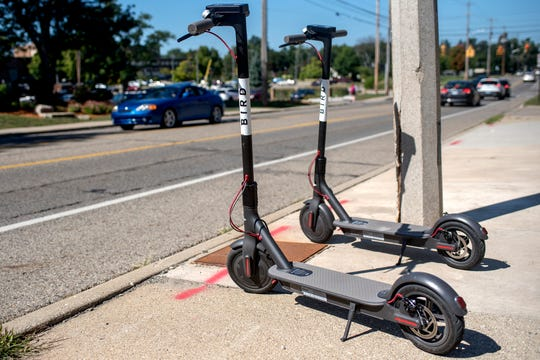 Two Bird scooters are parked along Abbot Road on Wednesday, Sept. 12, 2018, in East Lansing. Bird Rides Inc., an electric-scooter sharing service, is now available in East Lansing.