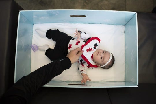 A Jan. 26, 2017 file photo shows a Camden N.J. infant in a baby box given to her mother. It is part of a public effort to reduce infant mortality.
