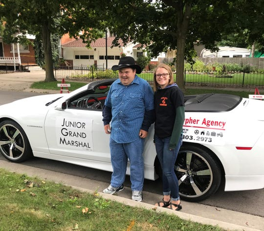 Michael Linton, with Charlotte High School student and friend Grace Driver, at the Charlotte Frontier Days Parade Sept. 8. Linton, 29, served as the festival's junior grand marshal.