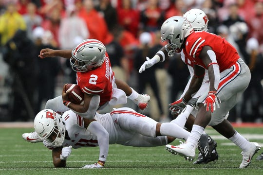 Texas transplant J.K. Dobbins, here carrying the ball for Ohio State in last week's game against Rutgers, was offered a scholarship by TCU when he was in ninth grade.