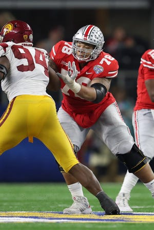 Ohio State guard Demetrius Knox throws a block in his last trip home to Texas. The Buckeyes beat USC in the 2017 Cotton Bowl at AT&T Stadium, site of Saturday night's showdown with TCU.