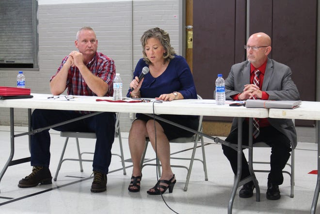 Director of buildings and grounds Scott Harvey, left, and Shelby superintendent Tim Tarvin, right, listen to school board president Lorie White, center, speak at a town hall at Auburn Elementary School on Tuesday, Sept. 11, 2018. The town hall was to discuss the district's bond issue on the November ballot.