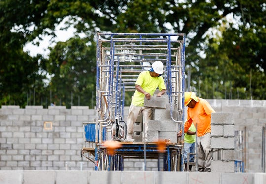 Masonry workers lay cinder block walls as construction continues on Germantown Municipal School District's new Forest Hill Elementary, which will open next year.
