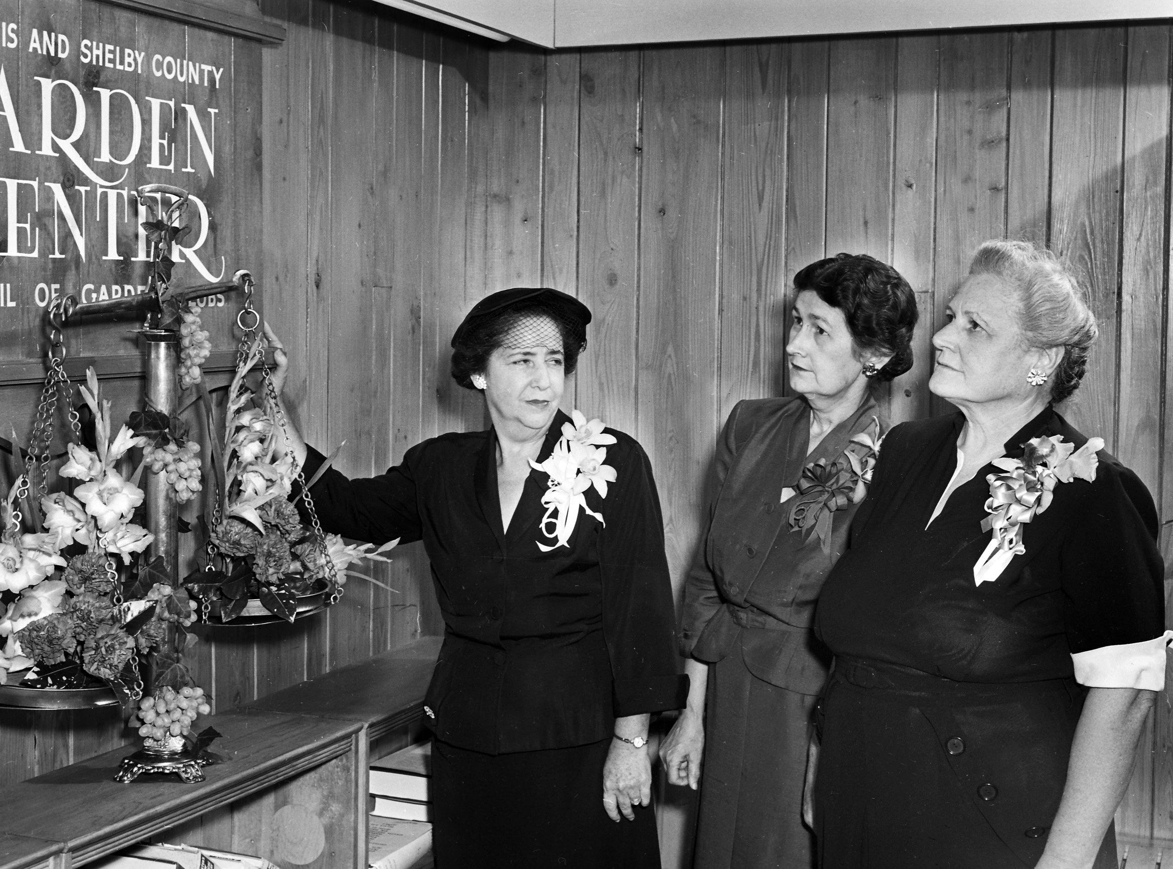 The Garden Center at 448 North Watkins welcomed the public to its exhibits and library of horticulture following an open house for the Memphis and Shelby County Council of Garden Clubs in September 1952.  Leaders in establishing the city's first permanent garden information clearing house are (From Left)  Mrs. Lemuel Earl Dickey of Germantown, president of the council; Mrs. Grace Walker Scheibler, director of the center and Mrs. J.A. Hamlet, chairman of the center.