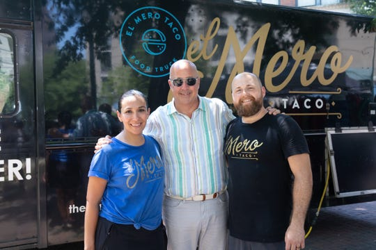 Jacob and Clarissa Dries, owners of El Mero Taco pose for a portrait with Andrew Zimmern, as seen on Big Food Truck Tip, Season 1.