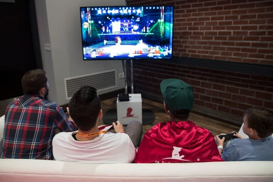 YouTube gamers enjoy a little friendly video game competition with St. Jude patients during a gaming event at St. Jude Children's Research Hospital on Friday, August 17, 2018.
