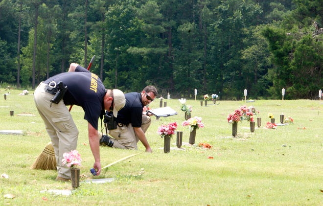 July 8, 2014 -  Agents with local, Tennessee and Georgia investigative bureaus descended on Galilee Memorial Gardens on Tuesday morning as authorities began their investigation into the extent of illegal burials that have occurred at the troubled Bartlett cemetery. (Karen Pulfer Focht/The Commercial Appeal)