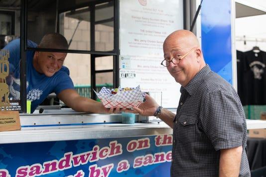 Mike Stanley Hands Andrew Zimmern His Order In His Food Truck Stanleys Sweet Street Treats