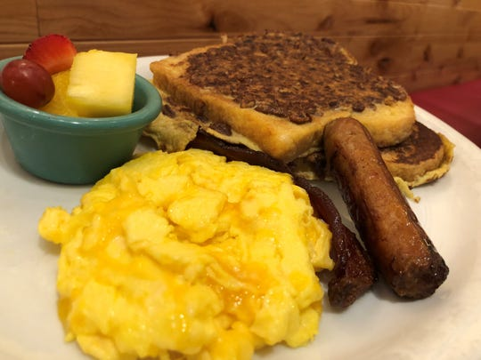 Two eggs, scrambled with cheese, sausage, bacons and pecan-encrusted French toast.