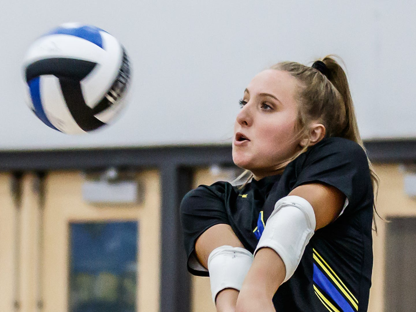 Mukwonago senior Hannah Powers (4) returns a serve during the match at home against Catholic Memorial on Tuesday, Sept. 11, 2018.
