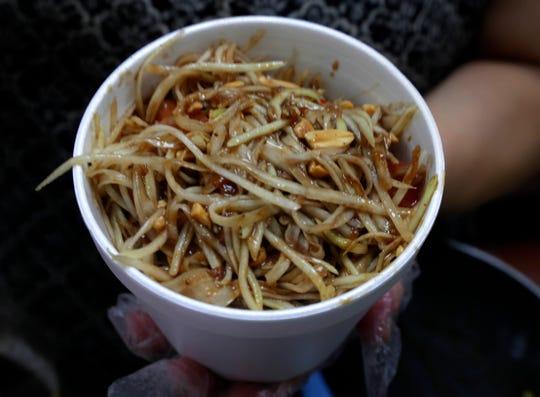 Papaya salad is a staple dish across Southeast Asia.