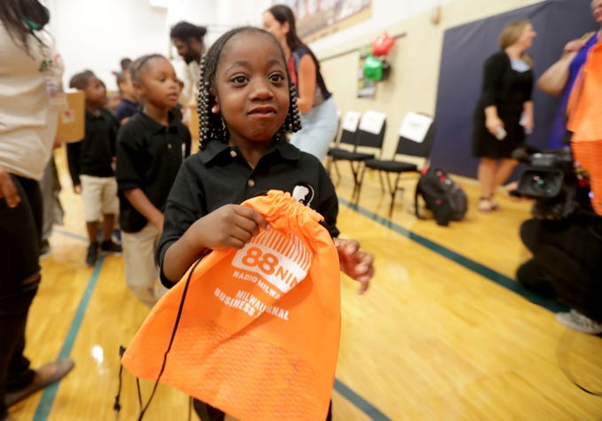 A'Vaehteyana Wade, a Dr. Martin Luther King Jr. Elementary School student, gets her backpack. Milwaukee Public Schools students received backpacks that they'll fill with school supplies donated by area residents through the third annual No Empty Backpacks School Supplies Drive at the school Wednesday. Students at a school assembly received more than 7,000 items, including 2,500 crayons and 1,600 pencils. Area residents dropped off items in July and August at 88Nine Radio Milwaukee, other area businesses and more than 50 other community drop-off locations.