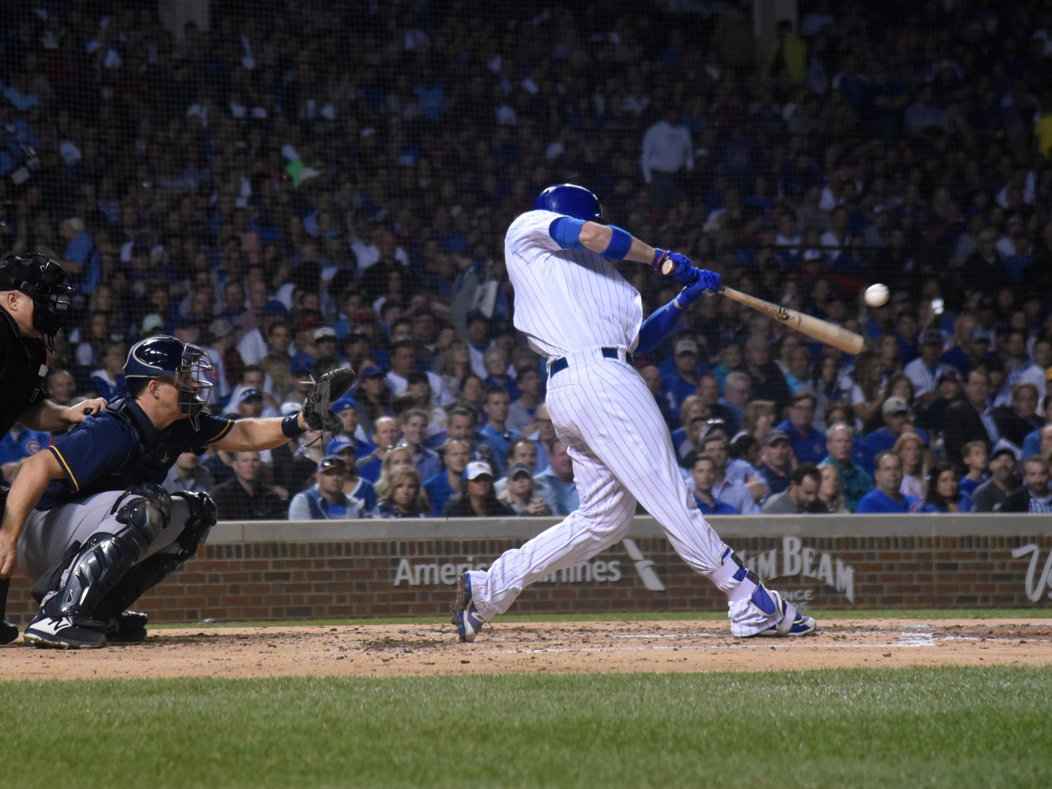Chicago Cubs' Victor Caratini  drives in a run with a single in the second inning.