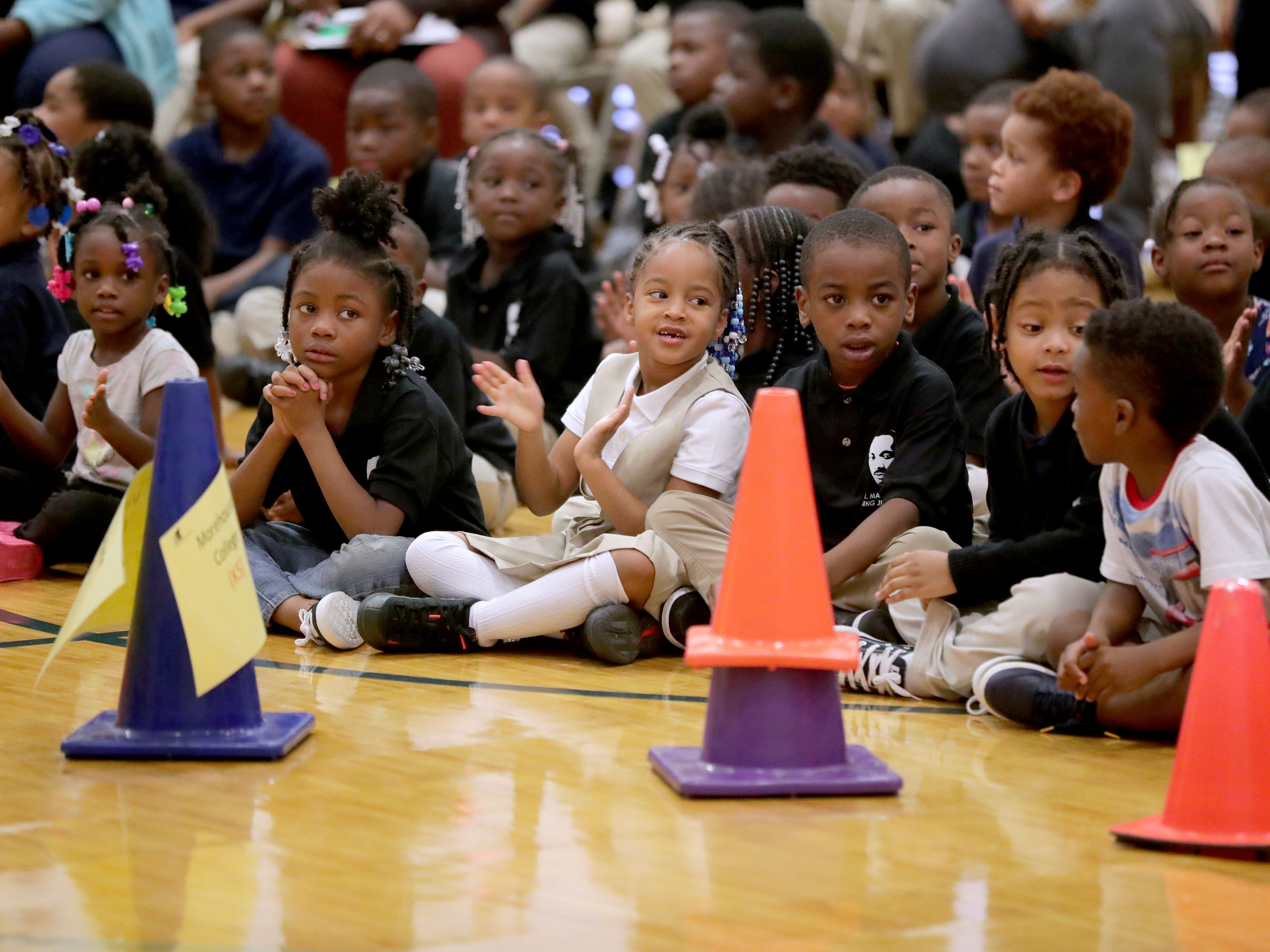 Dr. Martin Luther King Jr. Elementary School students applaud during an assembly Wednesday that was part of the third annual No Empty Backpacks School Supplies Drive.