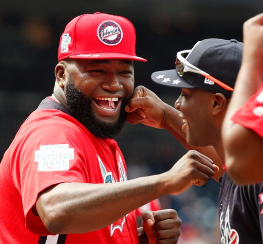 World Team Manager David Ortiz (34) speaks with U.S. Team Manager Torrii Hunter, before the All-Star Futures baseball game, Sunday, July 15, 2018, at Nationals Park, in Washington. The the 89th MLB baseball All-Star Game will be played Tuesday. (AP Photo/Alex Brandon) ORG XMIT: DCMS114