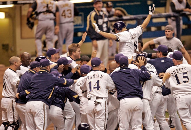 The Brewers' Ryan Braun jumps into the arms of teammates after a walk-off grand slam in the 10th inning at Miller Park on Sept. 25, 2008.