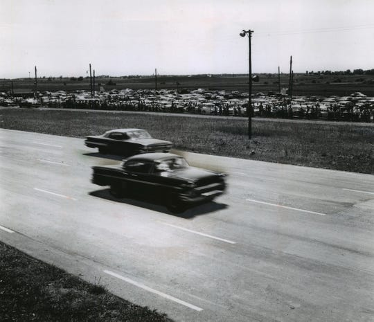 Spectators line the fence at Great Lakes Dragaway in this photo from 1960, five years after the track in Union Grove opened.