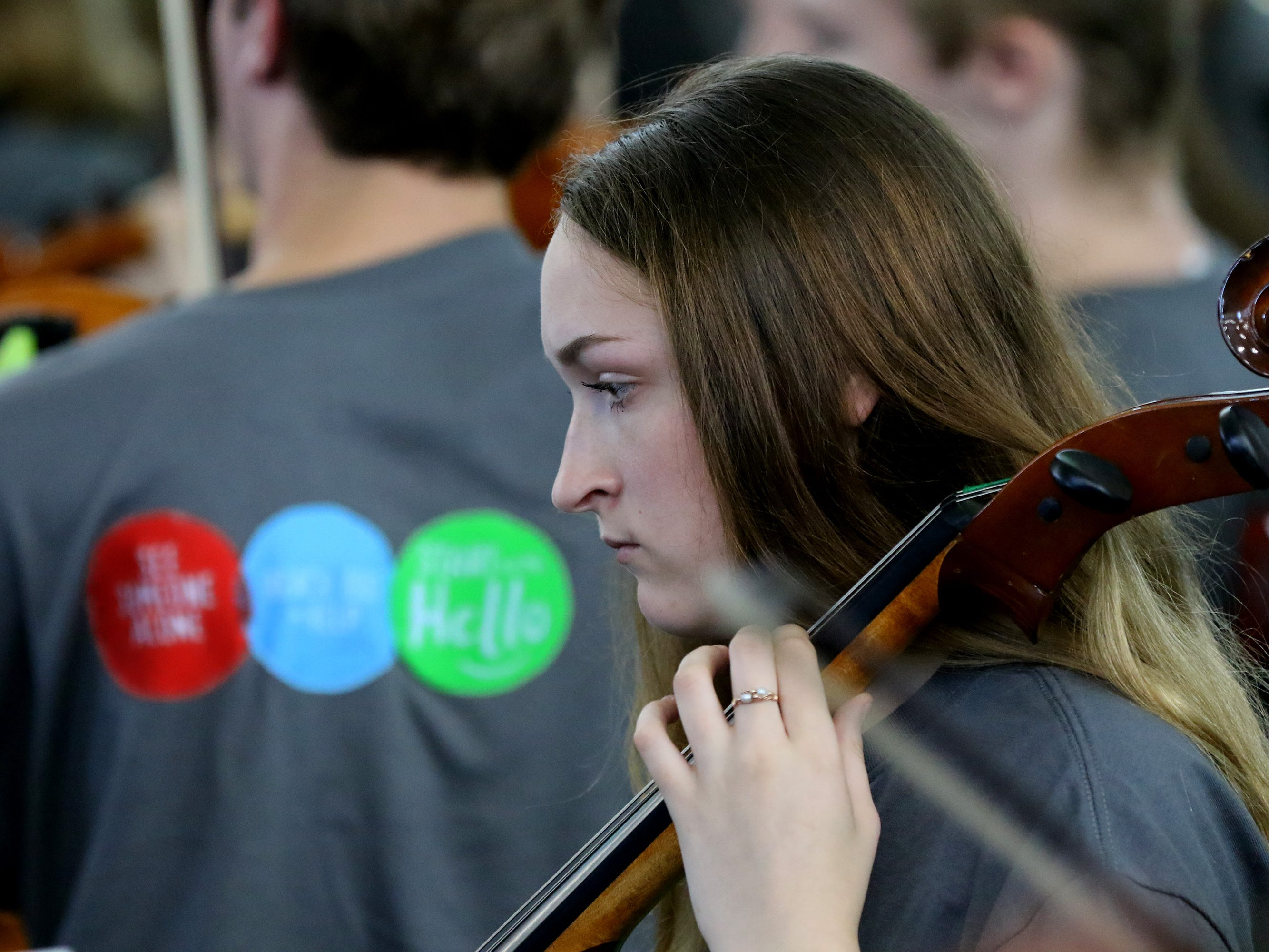 "Bethany Billington and other musicians premiere alumnus Nic Bizub's composition ""From Faded Light"" during a Sept. 12 all-school assembly to present the grand prize for the school's Start With Hello program from the Sandy Hook Promise project."