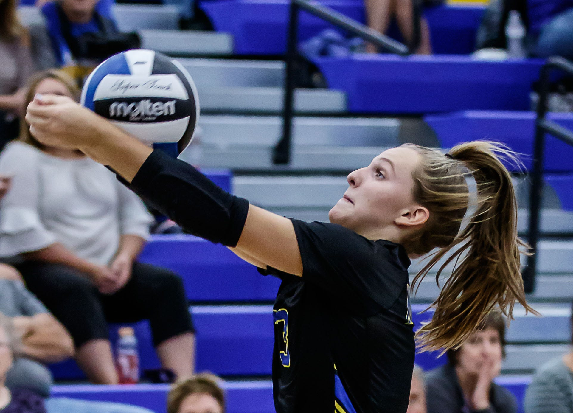 Mukwonago junior Erin Powers (3) makes an over the shoulder save during the match at home against Catholic Memorial on Tuesday, Sept. 11, 2018.