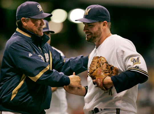 Brewers manager Ned Yost congratulates Ben Sheets, who pitched a five-hit, 1-0 shutout against the San Diego Padres at Miller Park on Sept. 6, 2008.