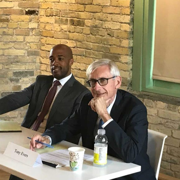 State Superintendent Tony Evers and his running mate, former state Rep. Mandela Barnes, are shown during a stop in Milwaukee. Evers has been weathering a storm of negative ads.