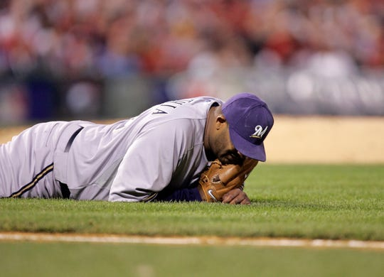 CC Sabathia is shown lying on the field after throwing out a Phillies batter during the second game of the National League Division Series at Citizens Bank Park in Philadelphia on Oct. 2, 2008.