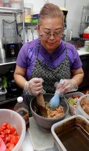 Papaya salad is a popular item at Yang's Cafe.