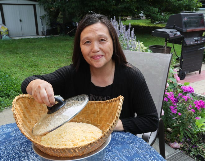 Chia Youyee Vang makes sticky rice the way her mother taught her.
