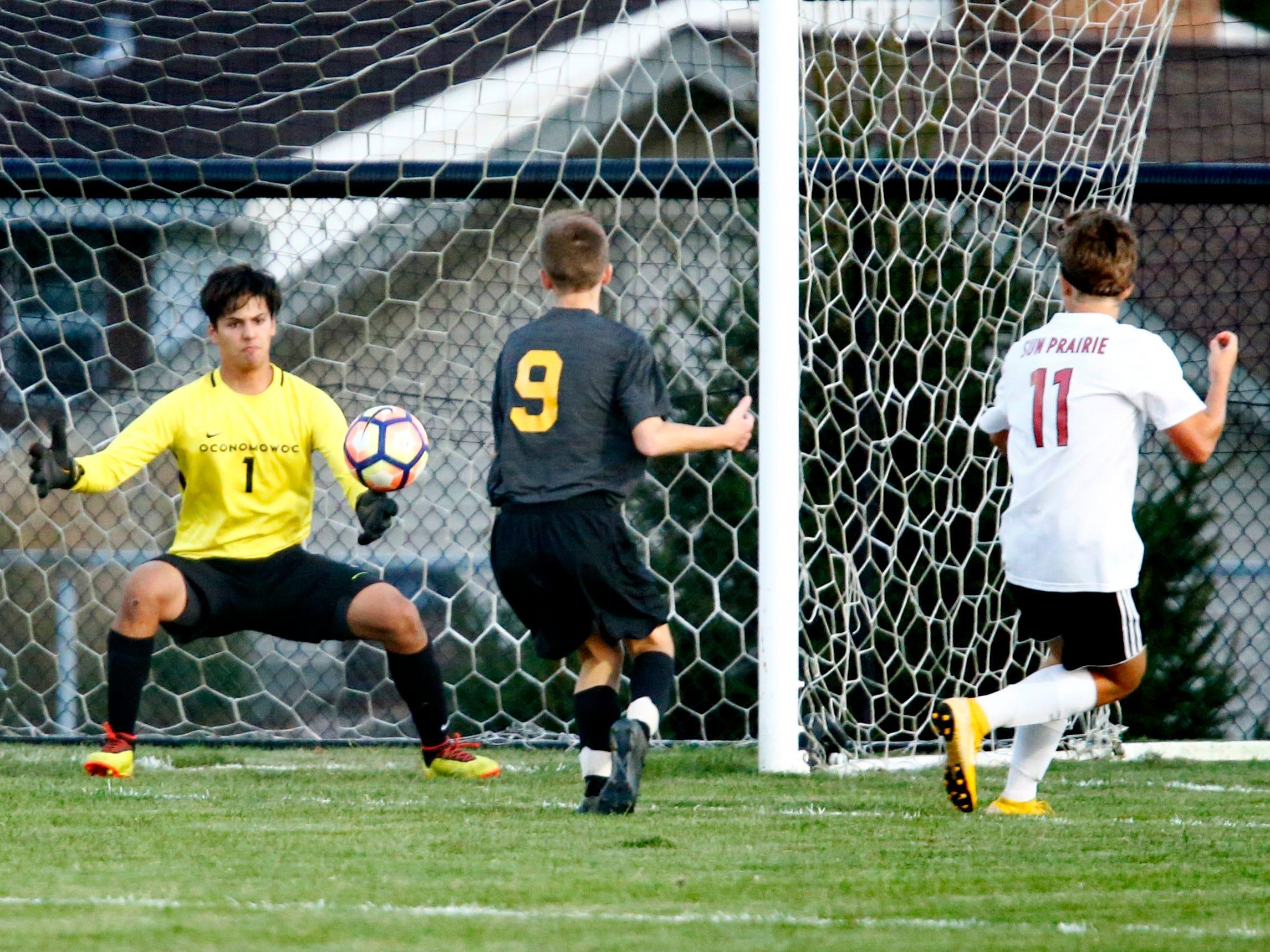Oconomowoc's Allen Valle blocks a goal shot by Sun Prairie's Andrew Weddle at Oconomowoc on Sept. 11.