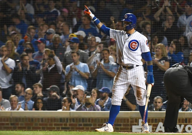 Sep 11, 2018; Chicago, IL, USA; Chicago Cubs shortstop Javier Baez (9) points after he scores against the Milwaukee Brewers in the second inning at Wrigley Field. Mandatory Credit: Matt Marton-USA TODAY Sports
