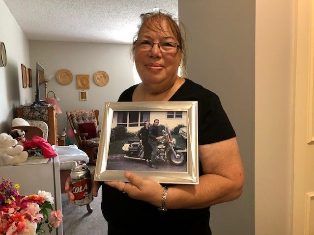 Betty Young of Mountain displays a photograph from around 1950 of her mother, Dora Uelmann, and her father on a Harley Davidson. Uelmann participated Wednesday in a motorcycling riding event in her honor.
