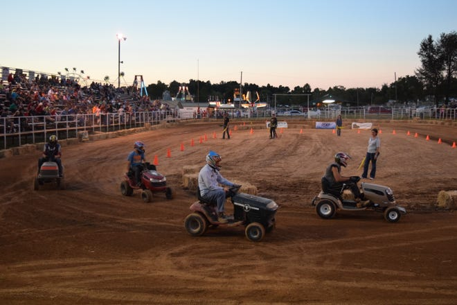 Local drivers compete in the lawnmower races at the Baxter County Fairgrounds. This is the fourth year the county fair has offered lawnmower races as an activity.