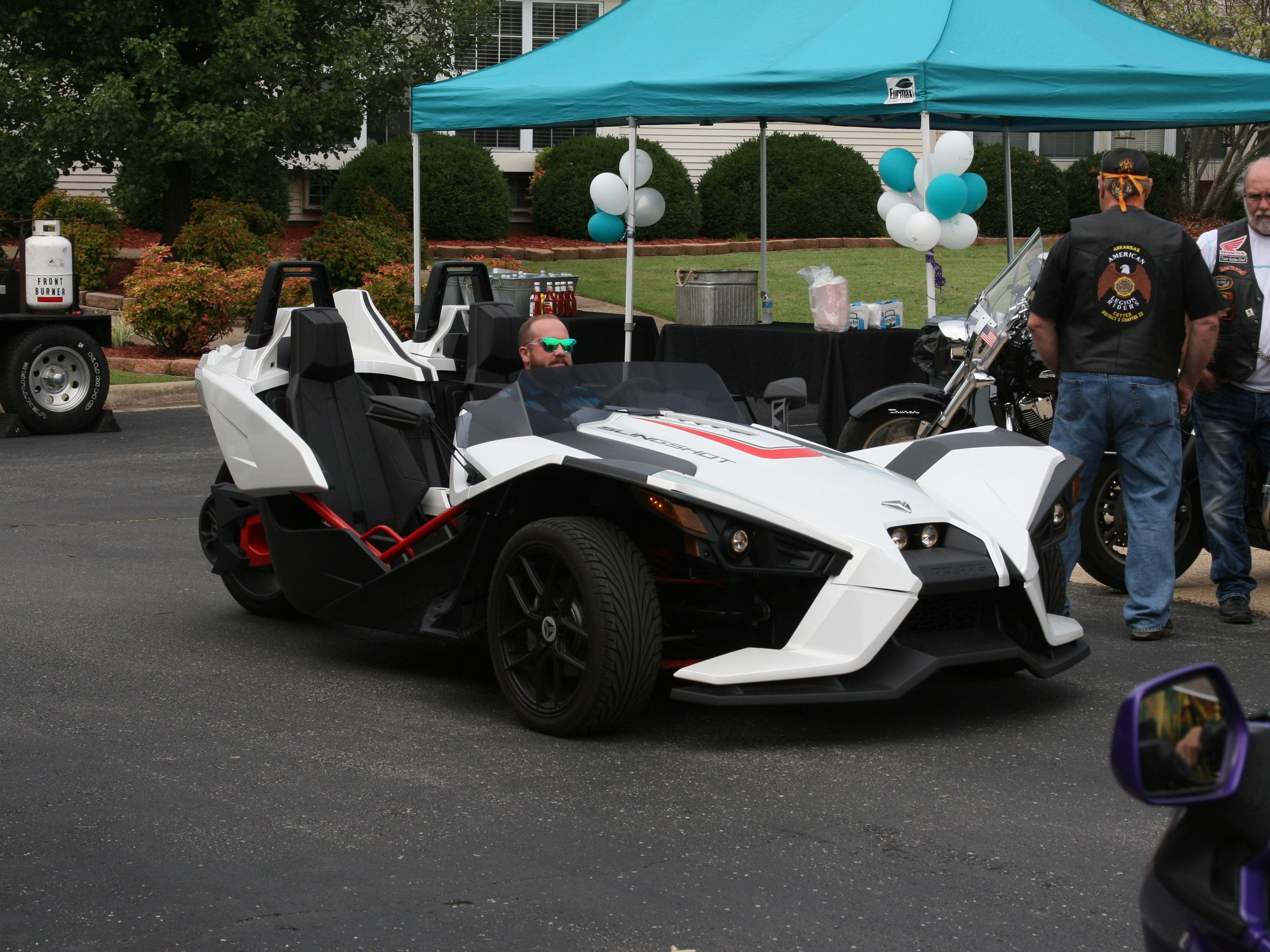 "Area podiatrist, Dr. Kevin Steffen Jr., provided three wheels for a community ride for 94-year-old Mountain Home resident Dora Uelmann. Dr. Steffen's Slingshot is a three-wheeled vehicle manufactured by Polaris and is a street-legal ""autocycle,"" so drivers don't need a motorcycle license to operate one."
